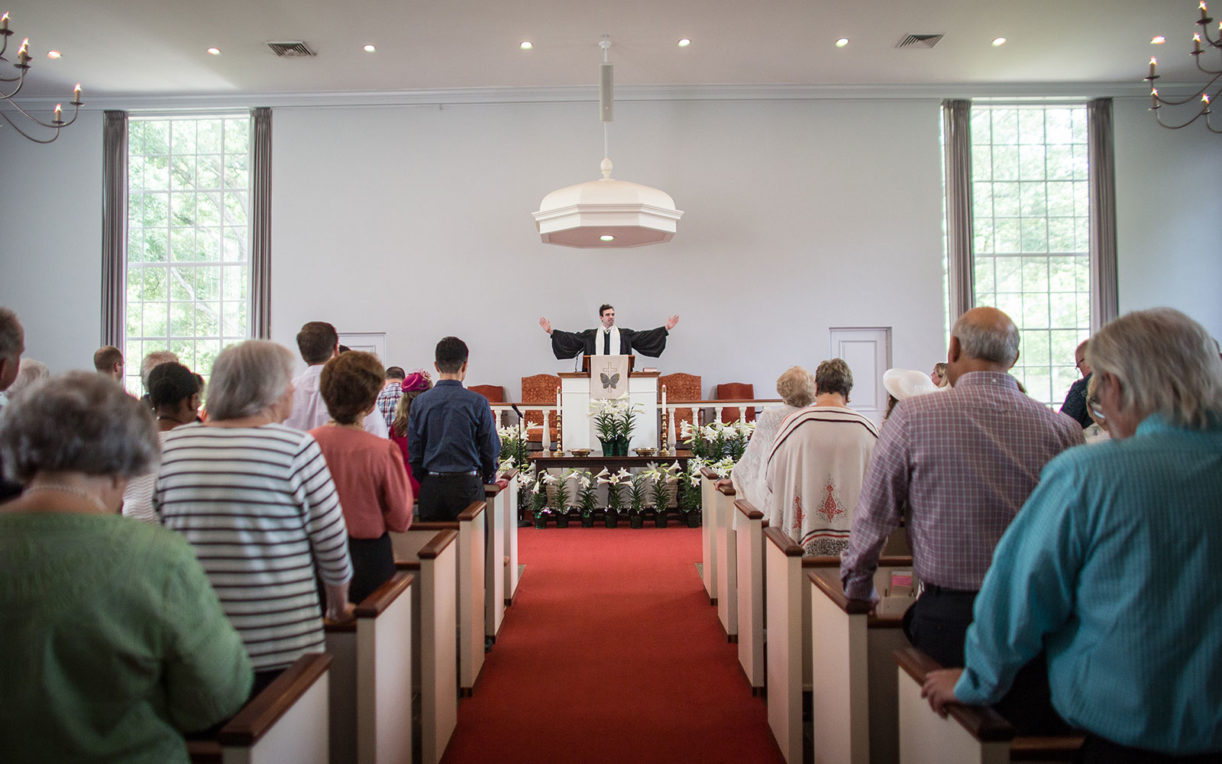 Preacher and standing congregation